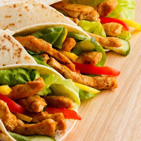 fast food: Chicken kebab wrap with vegetables Stock Photo