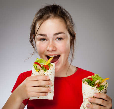 Girl eating chicken wrap