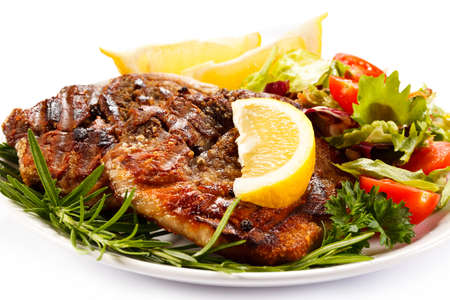 Grilled steak with lemon and vegetables photo