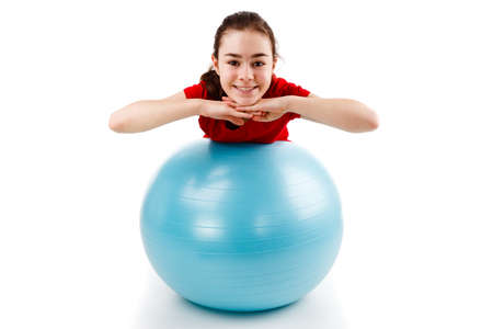 Girl exercising with a fitness ball Stock Photo