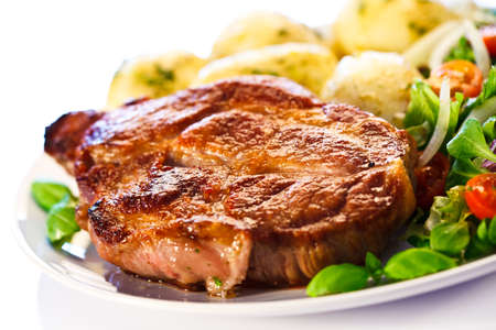 grilled pork chop: Grilled steak with boiled potatoes and vegetables Stock Photo