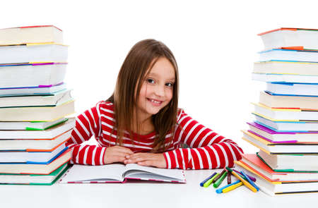 Girl surrounded by two stacks of books photo