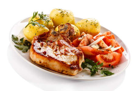 Grilled steak with boiled potatoes and vegetables photo