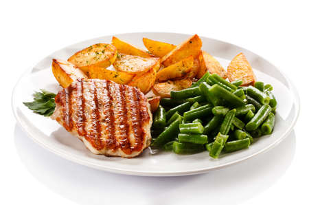 Grilled chicken with baked potatoes and vegetables