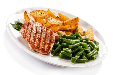 chicken grill: Grilled chicken with baked potatoes and vegetables