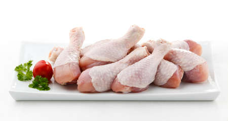 raw chicken: A plate of raw chicken drumsticks Stock Photo