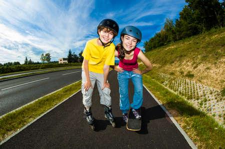 skateboarding: Girl skateboarding and boy rollerblading