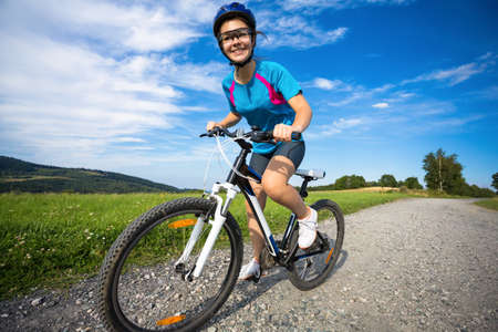 country side: Girl riding bike in the countryside