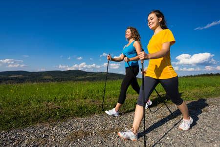 nordic walking: Two girls nordic walking