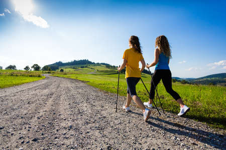 nordic walking: Two girls nordic walking