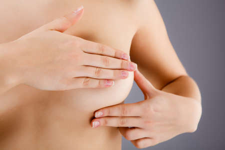 Beautiful breasts: Woman examining her breast Kho ảnh