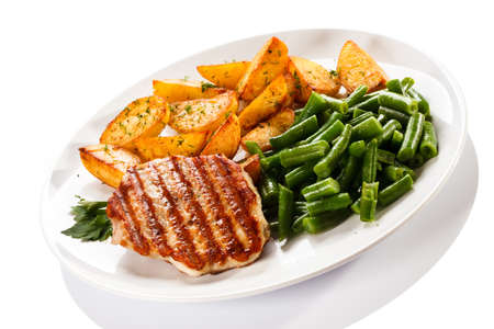 long beans: Close up of grilled chicken with vegetable and potato wedges