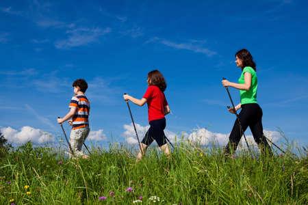 Family nordic walking in the field