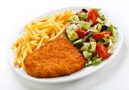 fried foods: Top view of fried chicken with fries and vegetables