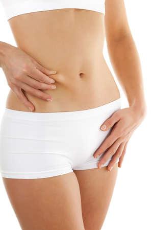 abdomens: Woman pinching her tummy fat