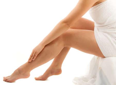waxed: Woman touching her leg Stock Photo