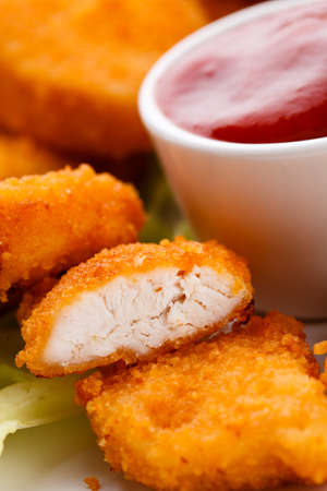 nuggets: Close up of nuggets with sauce