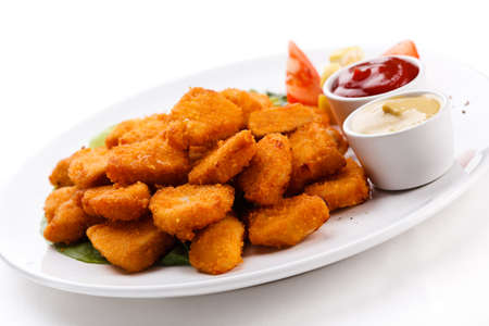 Nuggets with sauces on a white plate photo