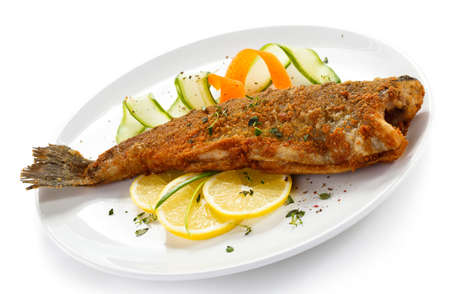 fried fish: Fried fish with sliced lemon on a plate