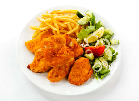 Top view of nuggets with french fries and salad photo