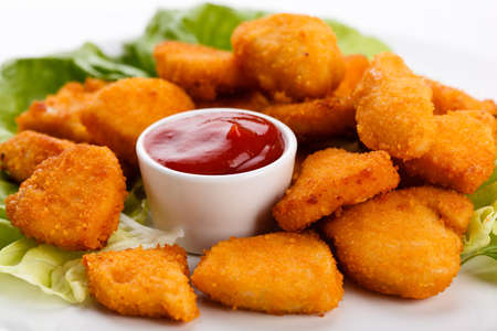 Close up of nuggets with sauce