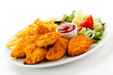 nuggets: Close up of nuggets with french fries and salad Stock Photo