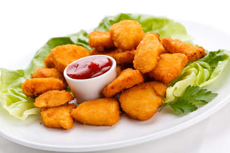 chicken nuggets: Top view of nuggets with sauce