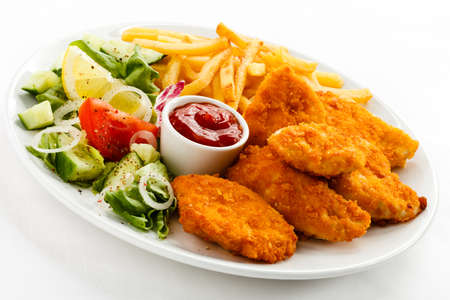Top view of nuggets with french fries and salad Imagens