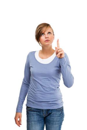 dedo indice: Mujer apuntando hacia arriba con el dedo índice