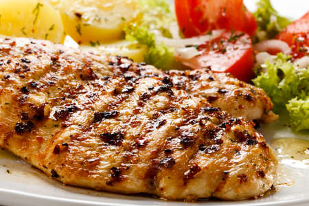 Grilled chicken with boiled potatoes and salad