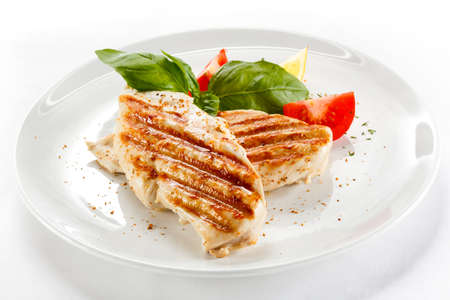 dishes: Top view of a plate of grilled chicken