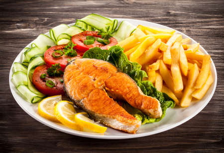Fried salmon and vegetables photo