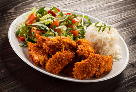 nuggets: Grilled chicken nuggets and vegetables Stock Photo