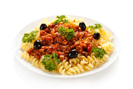 Pasta with meat tomato sauce and vegetables on white background Stock Photo