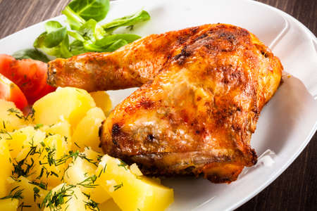 barbecued: Barbecued chicken leg with boiled potatoes and vegetables Stock Photo