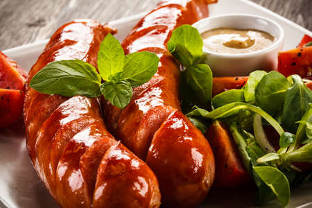 cooked sausage: Grilled sausages and vegetables