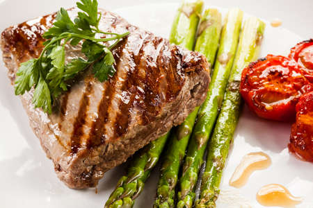 Grilled beef steak and asparagus photo