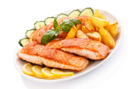fish plate: Grilled salmon and vegetables on white background Stock Photo