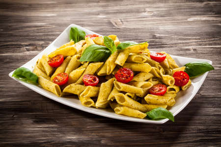 pasta sauce: Pasta with pesto sauce and vegetables
