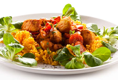 pearl barley: Roasted meat with pearl barley and vegetables on white background
