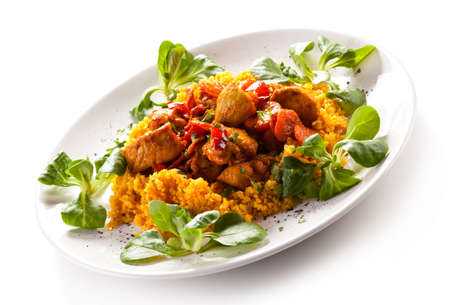 millet: Roasted meat with pearl barley and vegetables on white background