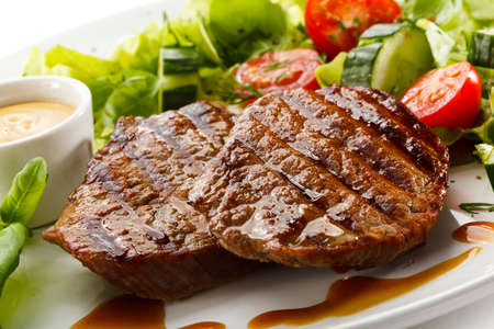 Grilled steaks and vegetable salad