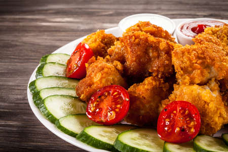fried: Fried chicken nuggets and vegetables