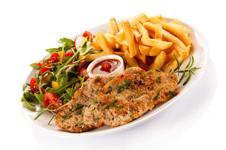 a portion: Fried pork chop, French fries and vegetable salad