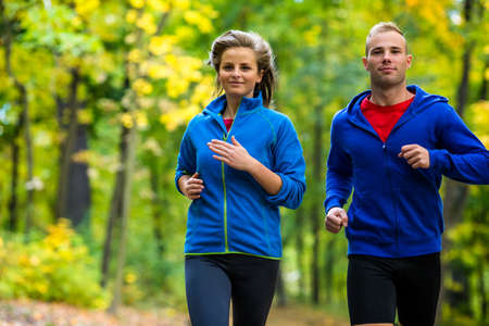 running man: Healthy lifestyle - woman and man running