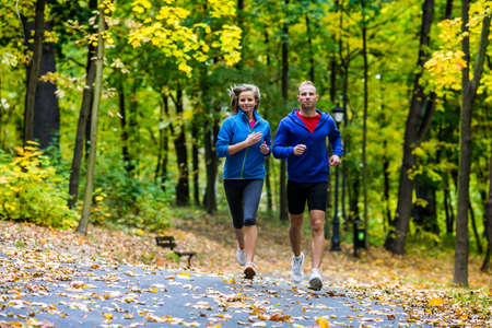 woman running: Healthy lifestyle - woman and man running