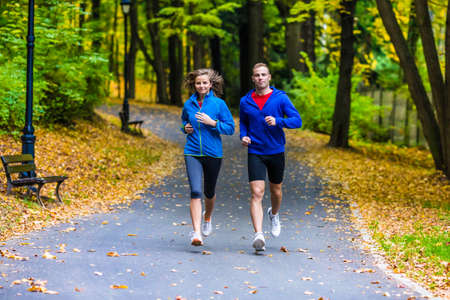 Healthy lifestyle - woman and man running. Stock Photo