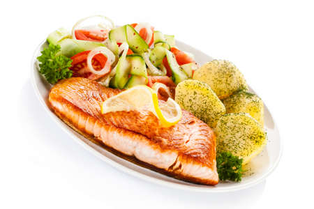 Fried salmon and vegetables on white background Stock Photo