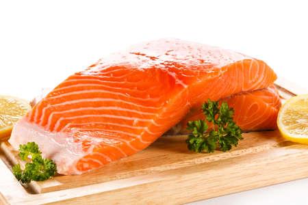 cutting board: Fresh raw salmon steaks on cutting board
