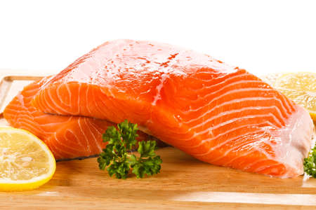 cutting: Fresh raw salmon steaks on cutting board